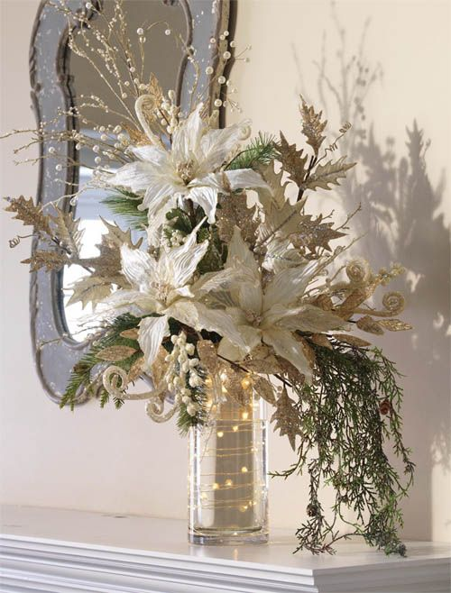 Winter floral arrangement idea. Could use as centerpiece. Love the wrapped wire lights.