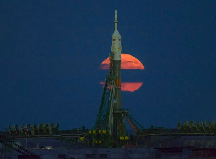 The supermoon is seen rising behind the Soyuz rocket that will launch the next crew to the International Space Station from the Baikonur Cosmodrome on Nov. 17.