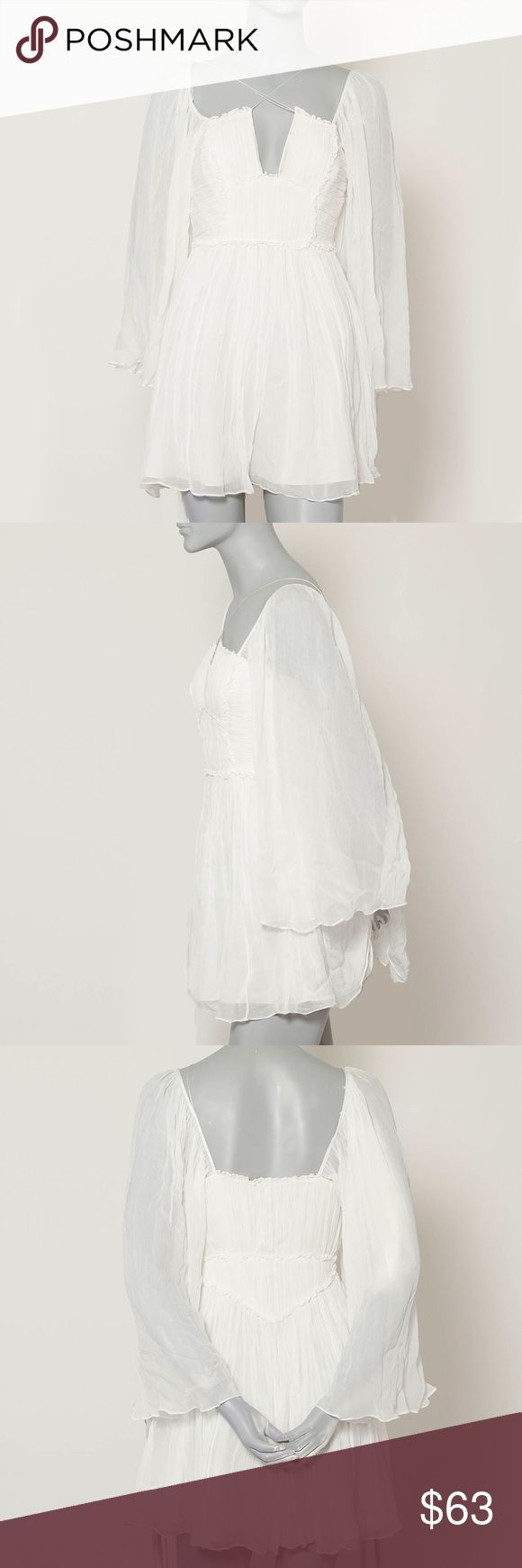 Free People Aquarius Dress in White- Size 0 NEW! Brand new without tags- Free People Aquarius mini dress- sheer flowing sleeves and skirt! Has cross string detail, one of the strings is broken, as shown in the last image!! Should be an easy fix though Free People Dresses Mini