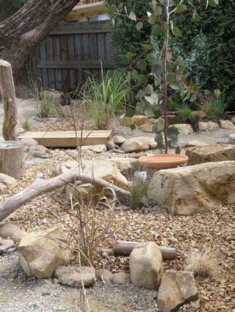 Irresistible Ideas for play based learning - dry creek bed, timber bridge, rock edging, native plants. Love it!
