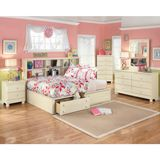 Ashley Cottage Retreat Full/Twin Bookcase HBD BRM with Storage Set - The Cottage Retreat youth bedroom collection takes early American country design to create a fun and inviting cottage retreat perfect for any child's bedroom. The replicated light cream paint with subtle replicated brushing flows over the graphic leaf design patterns and bead board panel accents creating a relaxing atmosphere that is sure to make any child feel at home. Create the special kid's bedroom with the refreshing…