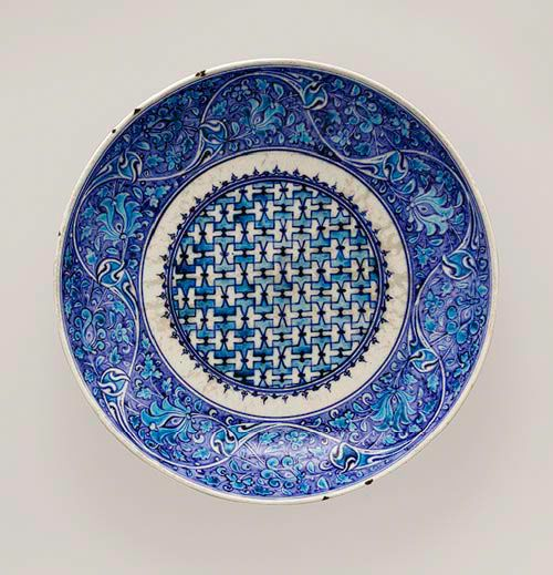 Dish [Turkey] (14.40.727) Ottoman period, 16th C Turkey, Iznik. Stoneaste in turquoise and two hues of blue under transparent glaze.