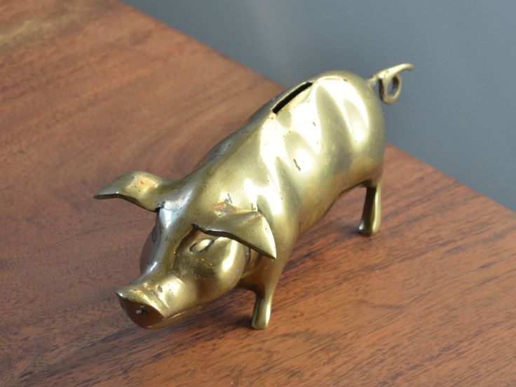 Brass Piggy Bank, Mid Century home decor, Hollywood Regency, brass animal decor, Slotted top for coins and money by Trashtiques on Etsy https://www.etsy.com/ca/listing/525461873/brass-piggy-bank-mid-century-home-decor