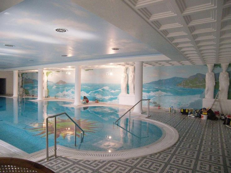 http://taizh.com/wp-content/uploads/2014/11/Futuristic-house-interior-design-with-wonderful-pool-indoor-and-blue-sea-wallpaper-and-blue-sky-ceiling-plus-lighting-ideas.jpg