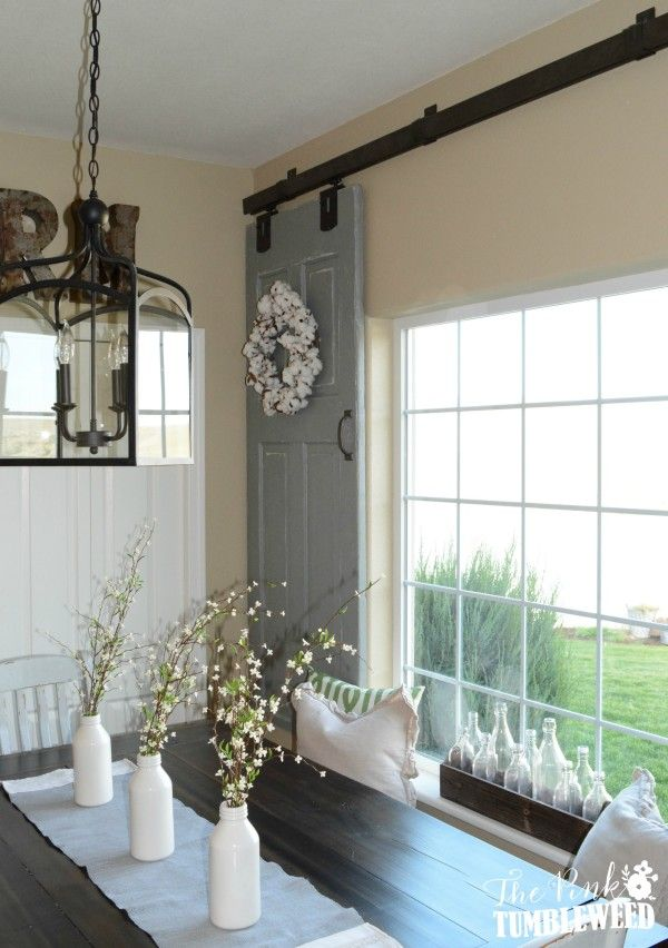 Barn Door Window Treatment - salvaged doors, hung from barn door hardware, are a clever replacement for shutters and add to the country farmhouse look - via The Pink Tumbleweed
