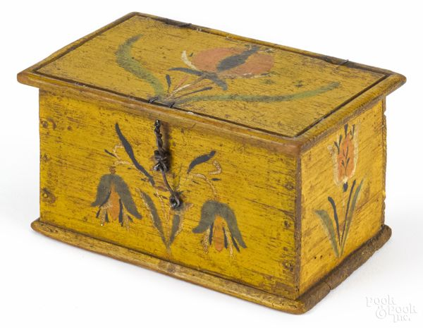 """Pook & Pook. Paul Flack Collection. October 3rd & 4th 2014 Lot 855. Jacob or Jonas Weber (Lancaster County, Pennsylvania, mid 19th c.), painted pine trinket box with floral decoration on a yellow ground, 2 1/2"""" h., 4 1/2"""" w. Paint wear. Overall good condition. Provenance: The Dietrich Collection. Estimated: $2000 - $4000. Sold: $4,200 hammer, $5,040 with premium."""