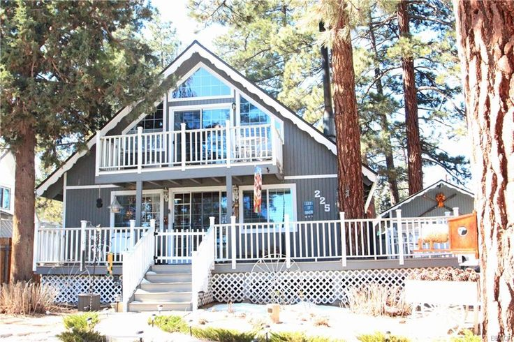 4 bedrooms, 2 (full) baths, fully fenced (7385 sf) lot in Big Bear $290,000 with 1 car garage, dual pane windows, central heat, fireplace, wrap around (composite) deck...