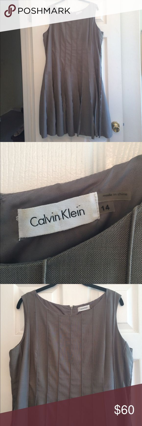 🍍Host Pick🍍 Fit n Flare dress Super cute grey dress from Calvin Klein. Excellent condition, wore once to a wedding. Very small spot on back (can be seen in lower left area of last picture). Extremely flattering cut and vertical stitching. Back zipper with hook and eye, all completely intact. Feel free to make an offer! Calvin Klein Dresses