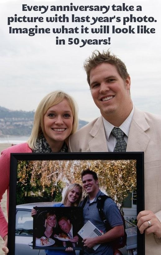 Take a picture with last years anniversary picture. Cute idea for couples.