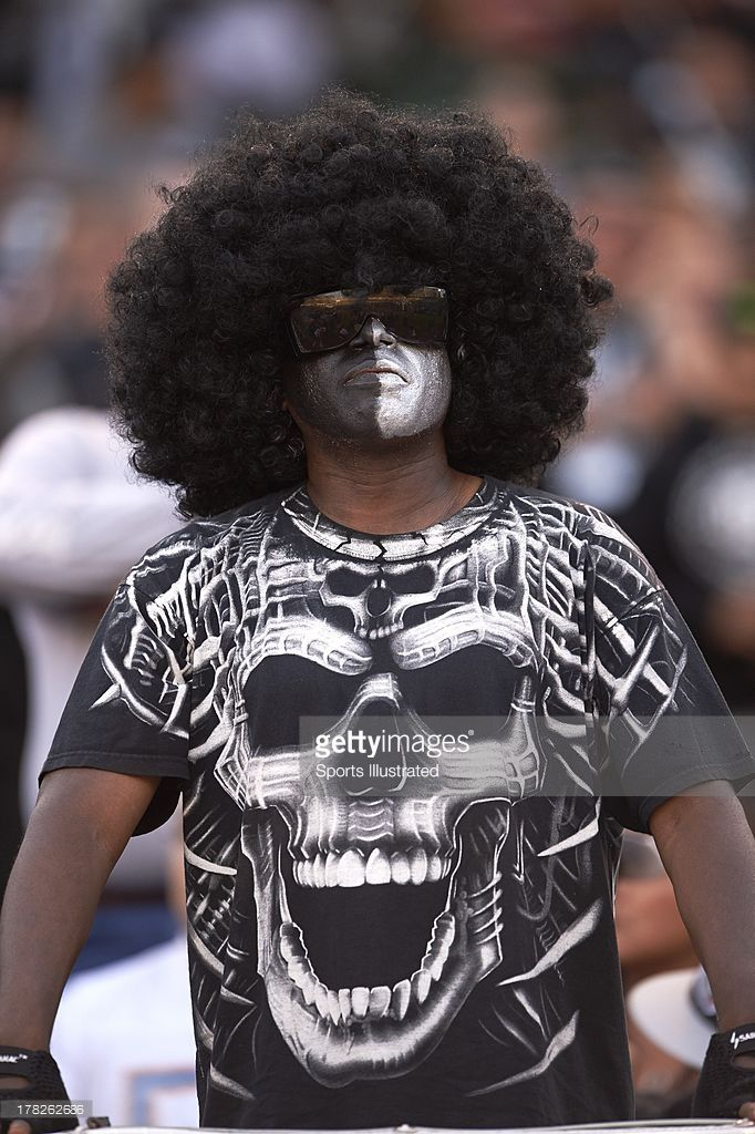 View of Oakland Raiders fan in makeup and costume during preseason game vs Chicago Bears at O.co Coliseum. John W. McDonough