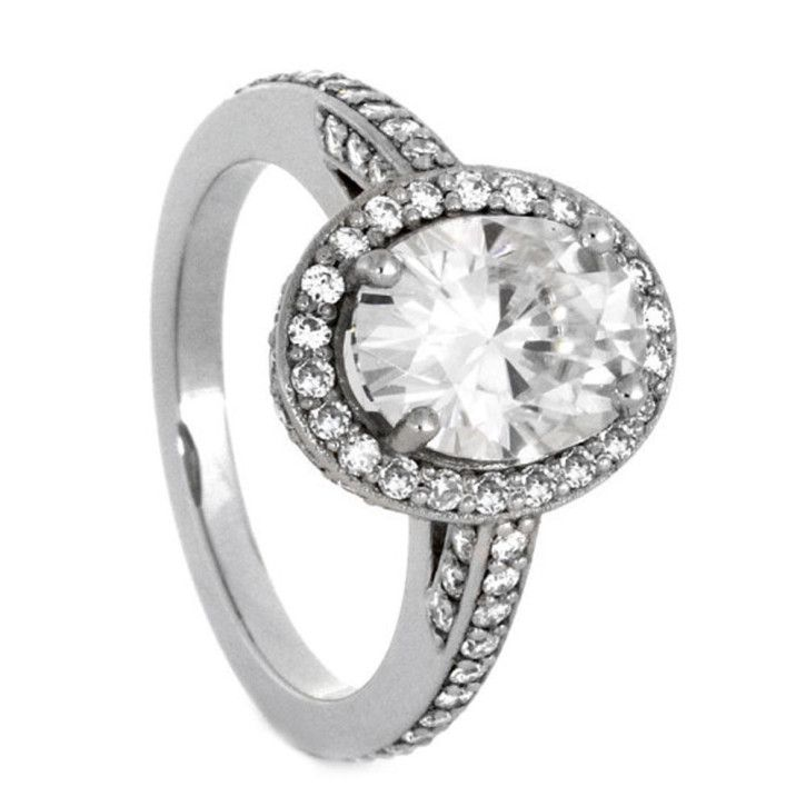 Glistening from every which way, this palladium engagement ring will match the sparkle in her eye.  See more here: https://jewelrybyjohan.com/shop/palladium-engagement-ring-halo-moissanite-2847/