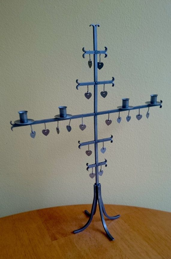 Check out this item in my Etsy shop https://www.etsy.com/listing/220819617/vintage-wrought-iron-candelabra-candle