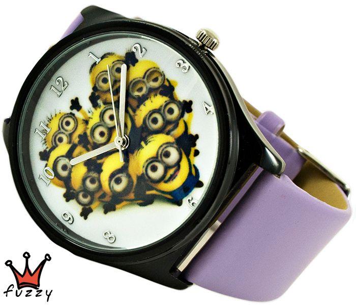 Ρολόι Minions, σε λιλά και μαύρο με παραστάσεις minions στο εσωτερικό του. Πλαστικό λουράκι σε λιλά χρώμα. Διάμετρος καντράν 40 mm.