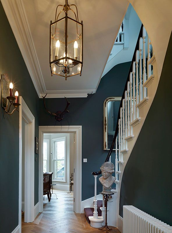 The ground floor entry hall retains original Victorian details and scale. What a great color.