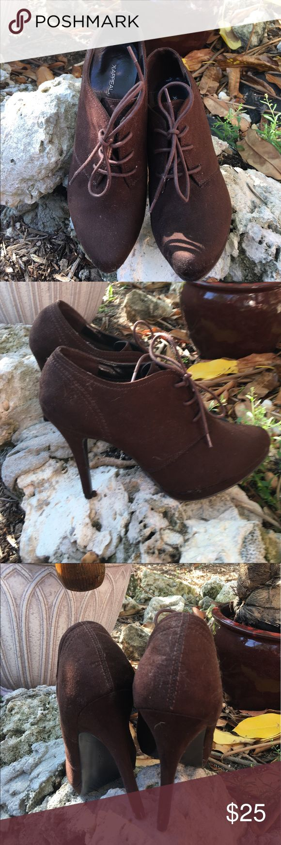 """XAppeal brown lace up  booties XAppeal brown lace up booties Never been worn! Daughter bought but have been sitting in closet! There is a mar on the heel of one see last pic- I am guessing happened from being in closet with so many other shoes! Price is reflective NWOT 4"""" heel height ✅I ship same or next day ✅Bundle for discount Xappeal Shoes Ankle Boots & Booties"""