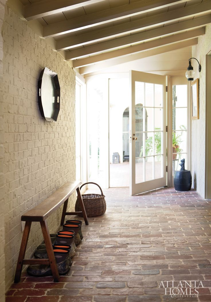 This simple mudroom, with brick flooring, provides a seamless transition between indoors and outdoors.