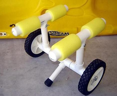 How to build your own kayak cart that is lightweight and floats for $25.  Purchase plans from this site. Appears to be made of push lawn mower wheels and axel surrounded by a configuration of PVC pipes and elbows.  Covered in foam; that looks like a dollar store pool noodle. Add a web strap band to hold kayak to the cart.