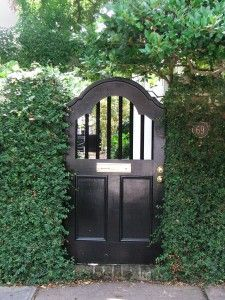 Garden Gate Ideas make a great entrance Black Wooden Garden Gate
