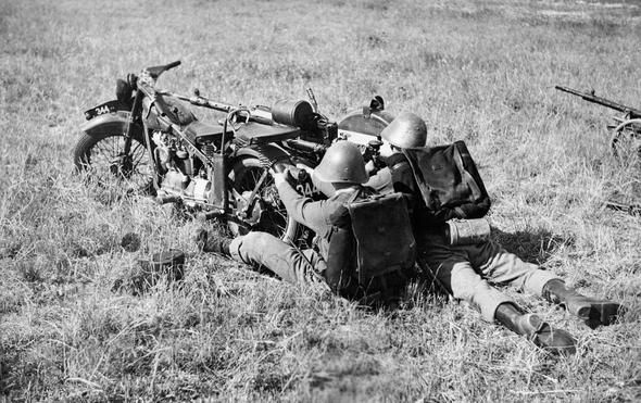 Danish soldiers with Nimbus motorcycle and 20 mm Madsen machine cannon.