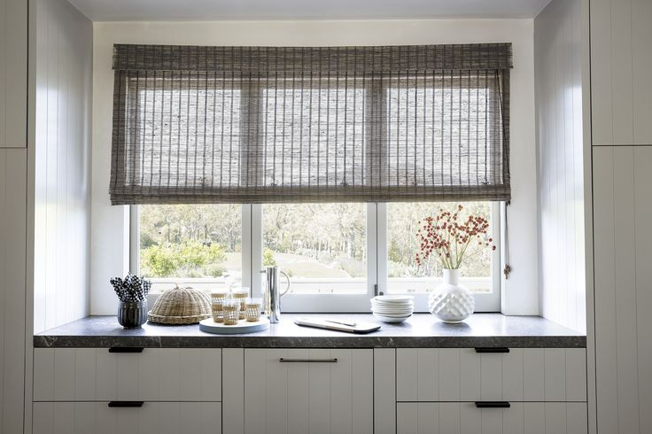 Long an interior designer favorite our natural woven for Natural woven flat fold shades