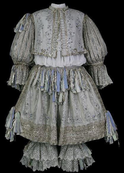 Comedie-Francaise, Jodelet costume: Jerkin of pearl-gray silk. Applications of silver lace, sequins, stones. Panties purple silk with silver mesh. Rhinegrave pearl gray silk, silver lace.  I love the tassels. I could use these to accent personality on the guys.