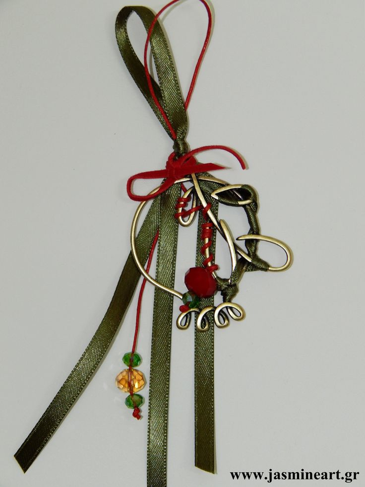 Γούρι ρόδι μπρονζέ  Ομορφο γούρι με μπρονζέ ρόδι περίγραμμα, γυάλινες και άλλες χάντρες δεμένες σε δερματάκι. Τιμή: 7.00 €