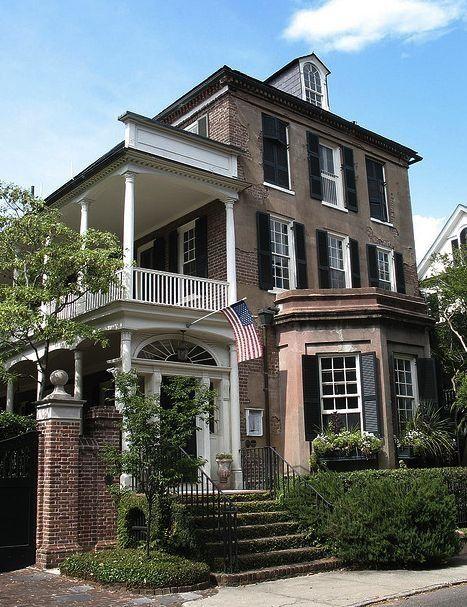 This unique brick home borrows from Queen Ann, American four square  & Italianate architecture.