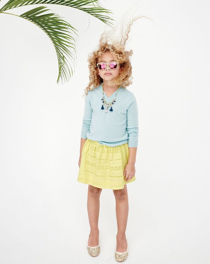 J.Crew girls' v-neck cashmere in heather aqua, pull-on eyelet skirt in vivid yellow, and tassel rope necklace.