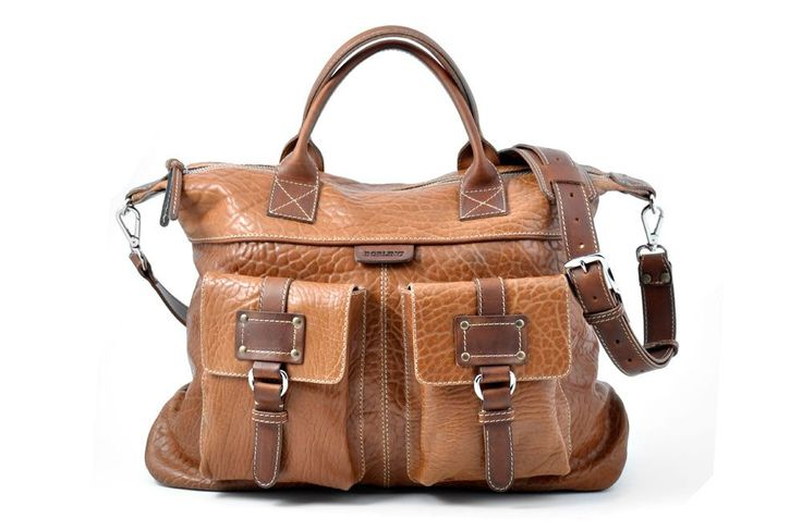 The beautiful Terra Buffalo trimmed with Terra Vachetta Leather Duffel is designed for the fashion conscience traveler who want to arrive in style.  #fashion #bags #italy #style #luxury #leather