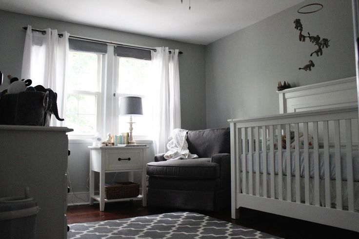Contemporary Baby Boy Room Design With White Wooden Crib Baby Also Couch Set On Corner Beside Lamp Desk Also White Sliding Curtain Window And Rug On Floor Along With Gray Painting Wall Decor Ideas Baby Boy Nursery Design Use Black and White Scheme http://seekayem.com
