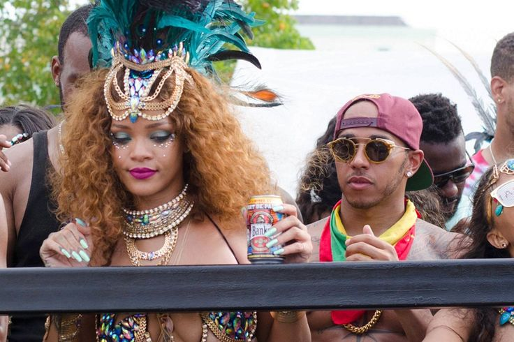 Rihannahas been partying in Barbados in honor of the island'sannual carnival, but it seems she hasn't been living it up alone! RiRi was spotted with Formula One race car driverLewis Hamilton, da...