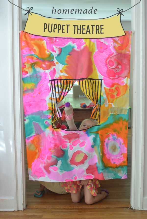 kids collaborate to paint the fabric in this homemade puppet theatre