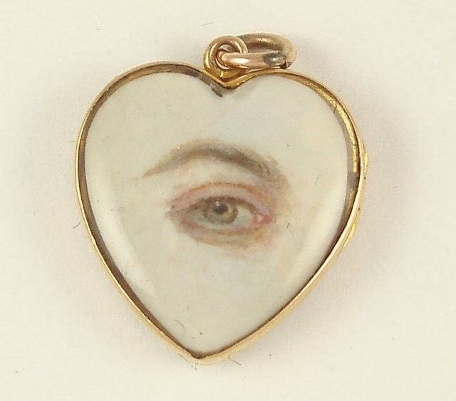 "LOVERS EYE ""Lover's eye"", eye miniature on ivory, c. 1830's. Hand-painted miniature of a left hazel eye on ivory in heart-shaped pendant. Eye miniatures or Lovers' eyes were Georgian miniatures, normally watercolour on ivory, depicting the eye or eyes of a spouse, loved one or child."
