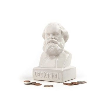 """Whether you're part of the bourgeoisie or the proletariat, we all need to save money, so stuff your own """"kapital"""" into the bust of the philosopher Karl Marx.  Ceramic.  White. Measures L4.63"""" x W 4.38"""" x H 7.5""""."""