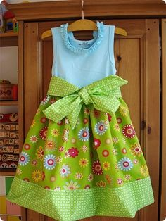 An adorable summer dress pattern for Emma! This may just be the thing that convinces me to finally practice sewing again. ;)