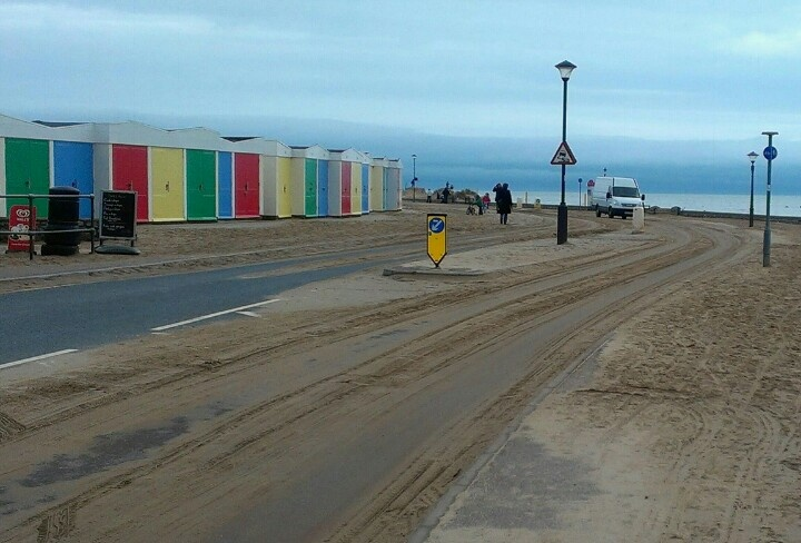 Beach temporarily reclaims road at Exmouth Sea Front, Devon, UK