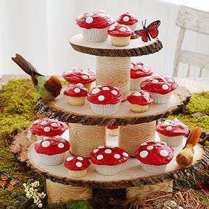 Forest Floor Decor-DIY Covered Cans and Wood Rounds Cupcake Stands (This is too cute! The cupcakes look like little toad stools) You can get the wood rounds here, if you don't have access to them ($5.49 and up): http://www.createforless.com/search/results.aspx?txtSearch=Walnut%20Hollow%20Wood%20Basswood%20Country%20Round
