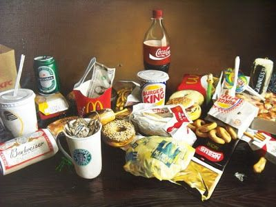 The photo displays fast-food products. The fast-food businesses have their old identity displayed on their products, indicating it's from the past.
