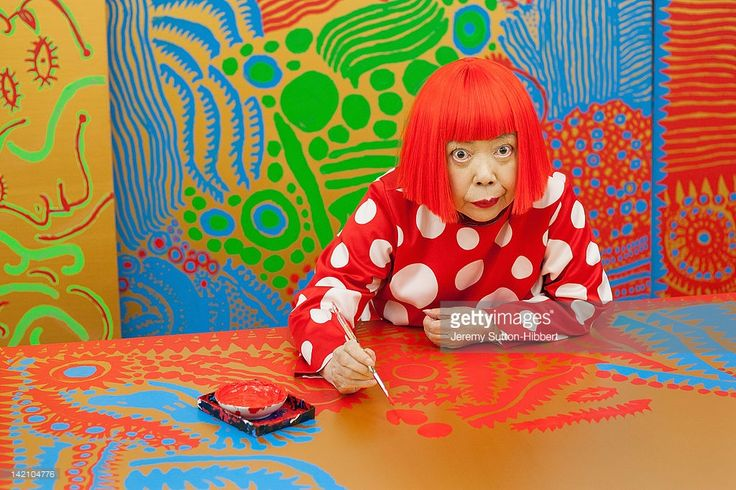 Japanese artist Yayoi Kusama sits working on a new painting, in front of other newly finished paintings in her studio, on January 25, 2012 in Tokyo, Japan. Yayoi Kusama, who suffers from mental health problems and lives in a hospital near her studio, is one of today's most highly revered and popular of Japanese artists. She is one of the world's top selling living female artists breaking records in the millions. A major retrospective of her work is on display at Tate Modern in London…