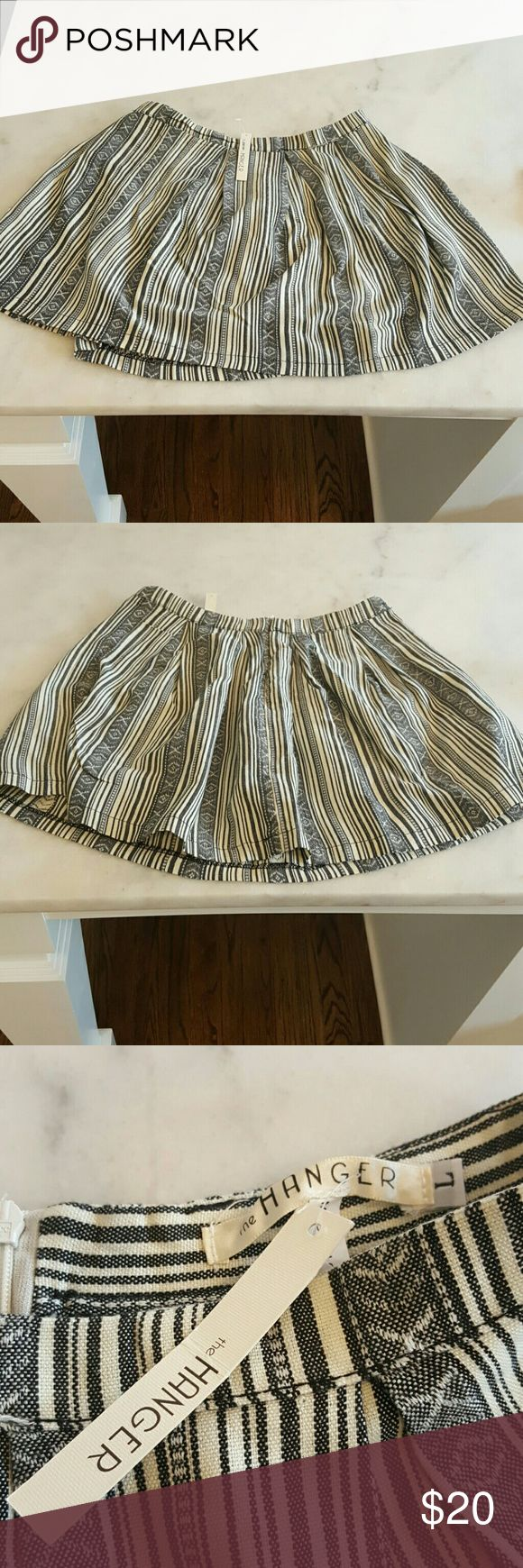 Tribal Print Skirt BRAND NEW w/ Tags 100% Polyester  Tribal Print  Hand wash cold or Dry Clean The Hanger Skirts