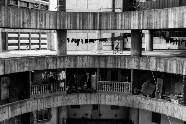 The Tower of David is an abandoned skyscraper built in downtown Caracas, housing about 1,300 families. Photos by Alejandro Cegarra