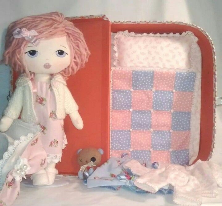 Complete with case, which doubles as a bed, bedding, dress, romper, cardigan, hat with 2bows, pjs 2pairs panties and shoes. And not forgetting her little teddy. All made using gingermelon patterns.