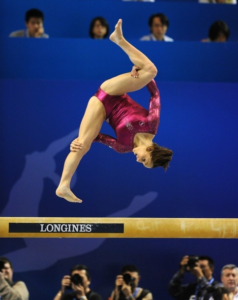 The dreaded side somi. Jordyn Wieber of the US performs during the women's balance beam final at the World Gymnastics Championships in Tokyo on October 16, 2011. Wieber won the bronze medal. #gymnastics #fig2011Tokyo