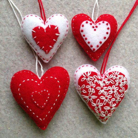 Red and white embroidered felt heart ornaments