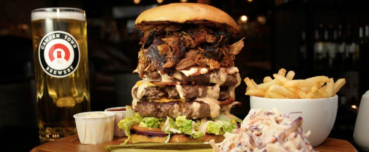 The Devastator: chuck-steak, American cheese, applewood smoked bacon and a load of  hickory-smoked pulled pork