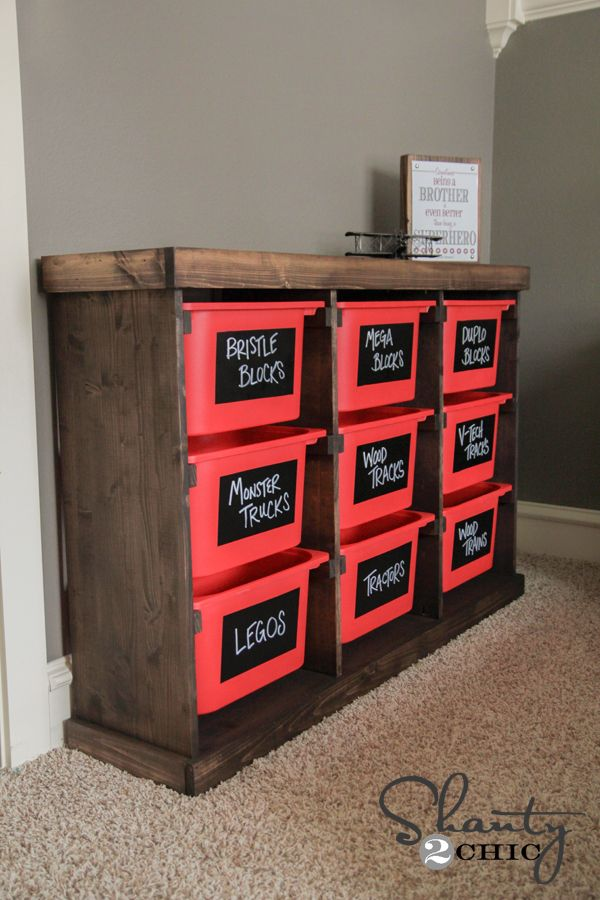 DIY Toy Storage Unit...Includes the plans for the custom cabinet too. This would look great painted a child's favorite color!