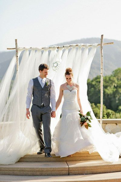 Birch And Flowing Tulle Arbor Add Ribbons In Wedding Colors