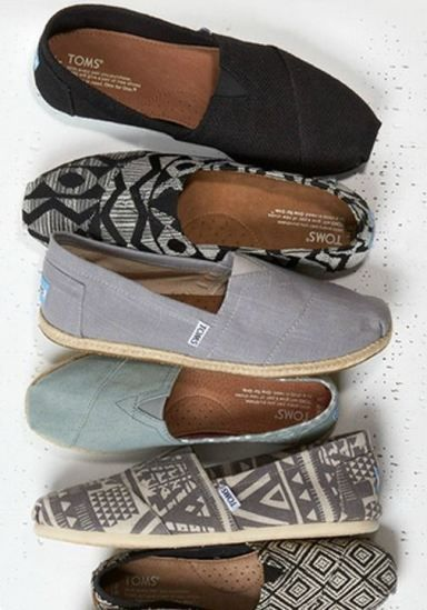 TOMS-I wear size 8 in these. I love them all in this group, very me. By the way, I have the bottom pair (black diamond design) and I also have a pair of plain silver Tom's canvas slip ons. I also have the Tom's taupe wedges.