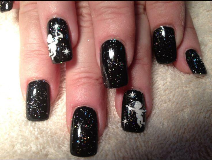 Black Christmas nails.