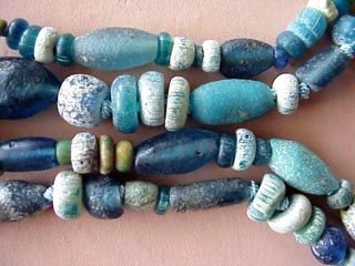 "Ancient Roman Glass Beads   Found along the trade route passing from Europe through northern Africa, these ancient Roman glass beads are a treasure! The beads vary in size and shape and all show the beautiful pitting from being buried in the sand for centuries. The beads are strung and knotted on silk to show the individual coloration and surface textures of each bead.   They are truly a timeless piece of jewelry for the collector!  Necklace length: 16 1/2""  #21318   $395"